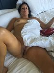 Melissa relaxing in bed in our suite at a downtown hotel.  She was just get...