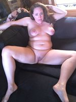 Susan with legs open and fully exposed.