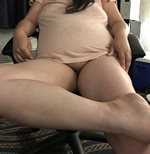 My wife sitting with her legs crossed. Showing her pussy