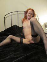 Redheaded slut on her bed