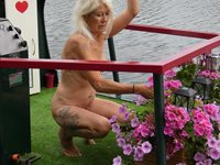 Pinklady3 tending the flowers on her boat. Don't they look beautiful!
