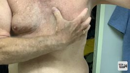 Hubby enjoying playing with his man boobs.  Who wants a squeeze?  From Mrs....
