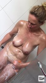 Having a shower , tributes for more vids x